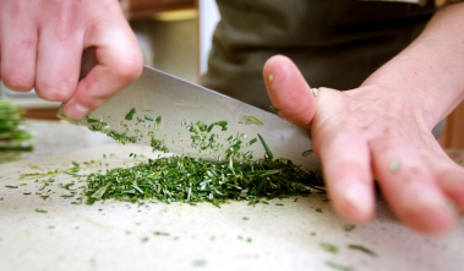 Chef chopping herbs