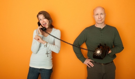 Two people on telephone