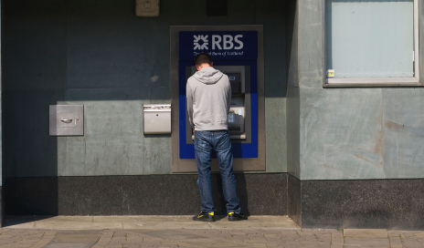 Man using RBS cash machine