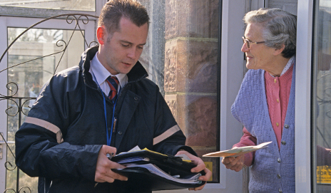 Salesman talking to woman on doorstep
