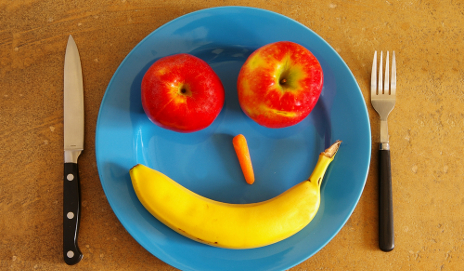 Smiley face made from fruit and veg