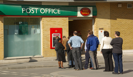 People queuing outside post office
