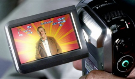 Stephen Fry on a video camera