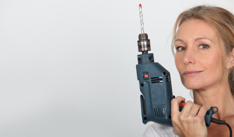Woman holding a drill