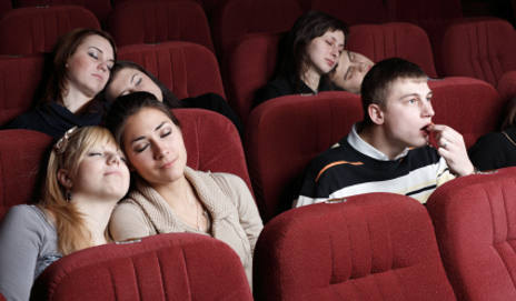 People bored and asleep at cinema