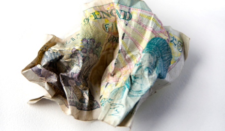 Crumpled five pound note
