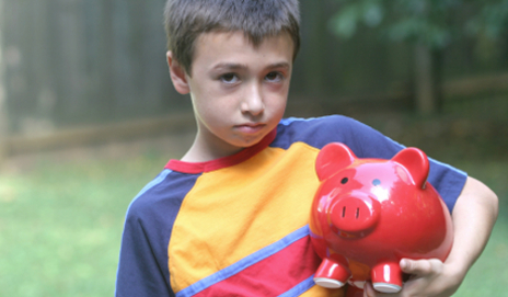 Sad kid and piggy bank