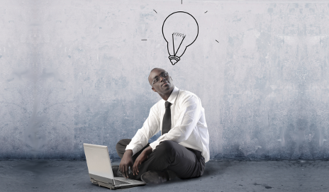 Man on laptop with idea bulb