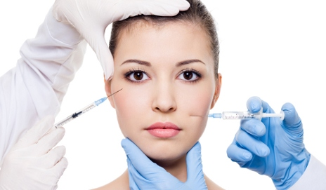Woman having injectable treatment