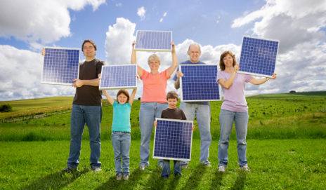 People holding solar panels