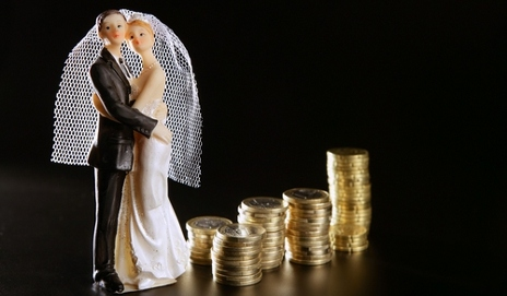 Married figures alongside piles of coins
