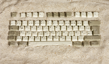 Keyboard in the sand