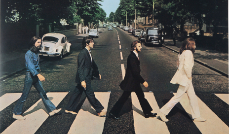 The Beatles Abbey Road album cover walking across zebra crossing
