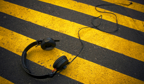 Headphones on road crossing