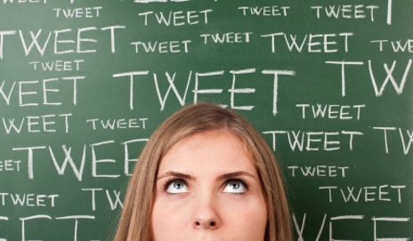 Woman and blackboard covered in the word 'Tweet'