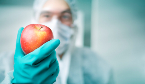 Scientist holding up an apple