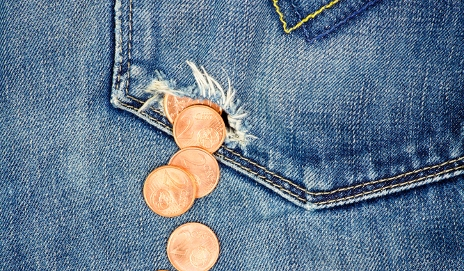 Money falling out of jeans pocket