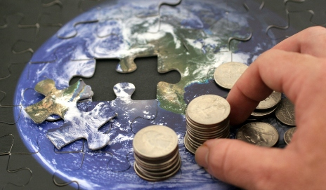 Puzzle of world with coins