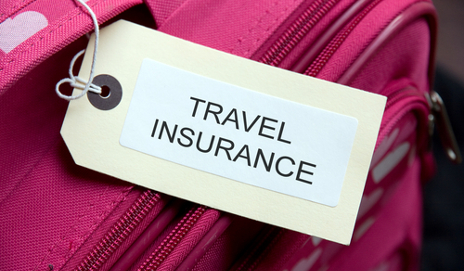 Pink suitcase with travel insurance label