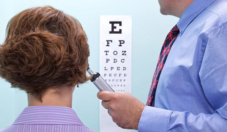 Optician conducting an eye examination