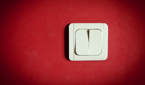 a big switch on red background