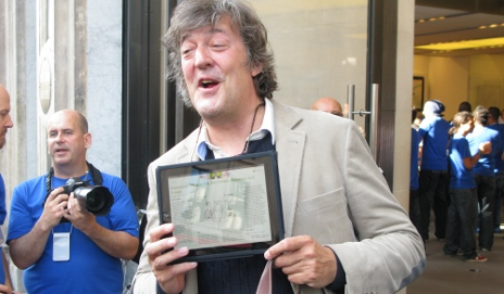 Stephen Fry holding an iPad