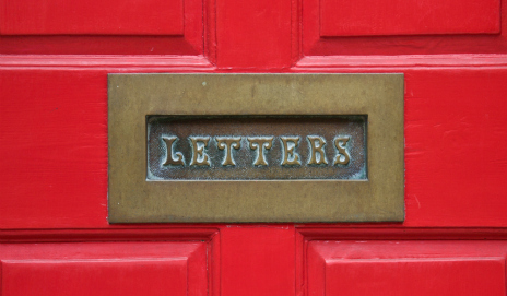 Letterbox on red door