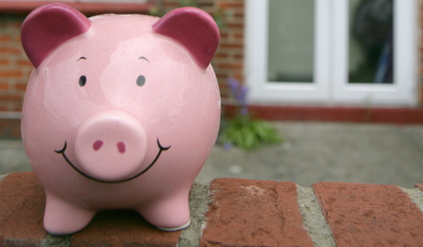 Piggy bank on wall outside house