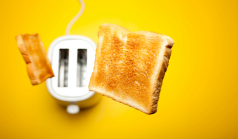 Toaster flinging toast into the air