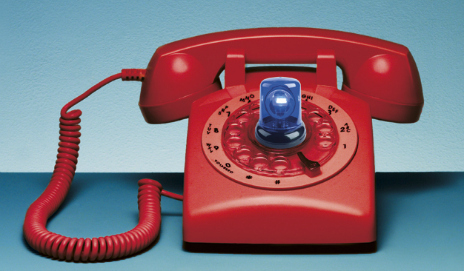 Red telephone with blue flashing light