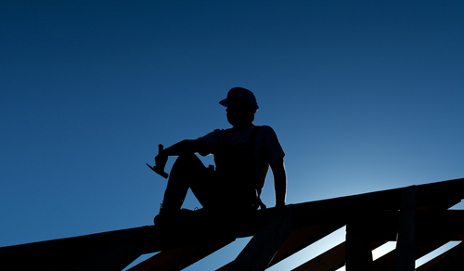 man on roof in silhouette
