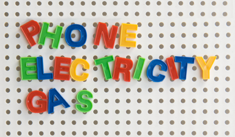 phone electricity gas spelled out in fridge magnets