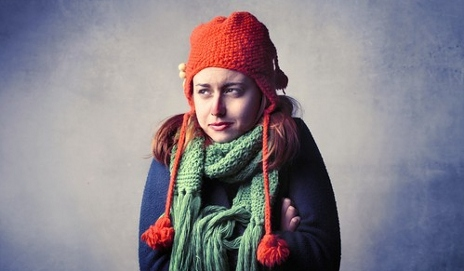 Girl with scarf and hat on feels the cold