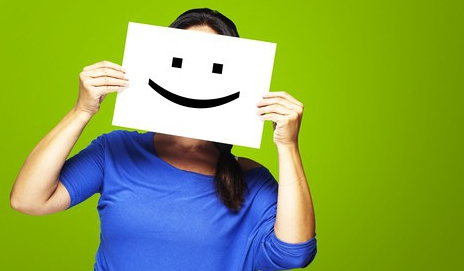 Female with cardboard cut out smile
