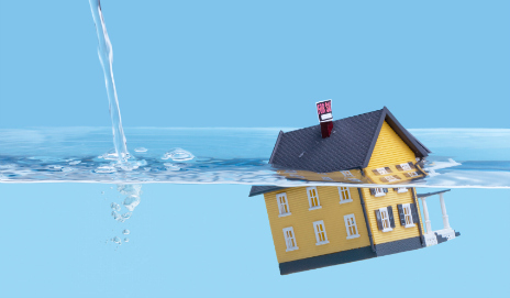 A picture of a house sinking in water
