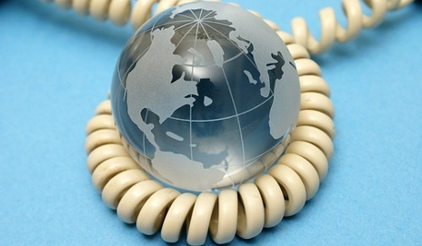Telephone wire wrapped around globe