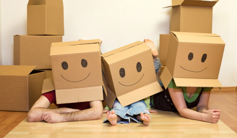 A happy family wearing cardboard boxes on their heads