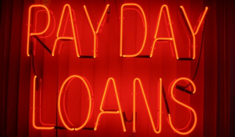 A neon sign saying payday loans