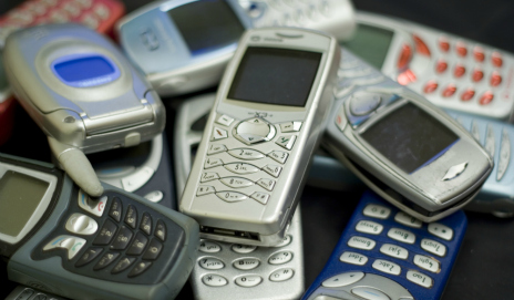 A pile of obsolete mobile phones
