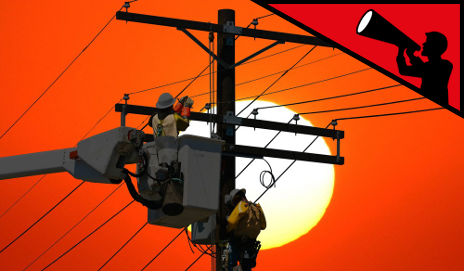 Men working on overhead power cables during sunset