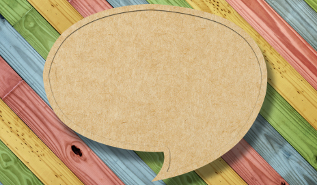 A speech bubble on a rainbow-striped background