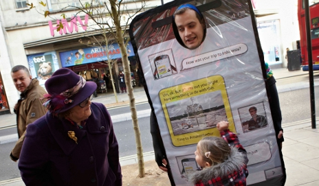 Friends of the Earth campaigner dressed in smartphone costume