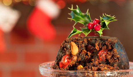 Luxury Christmas pudding with a sprig of holly on top