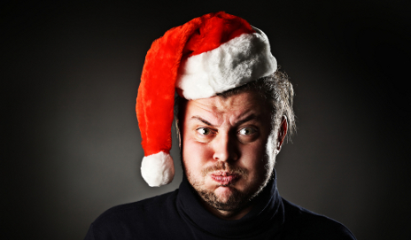 Angry man with Christmas hat