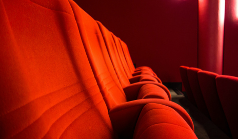A row of red seats in a cinema