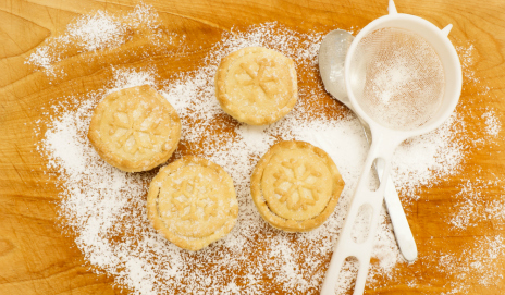 Home-made mince pies with icing sugar and a sieve