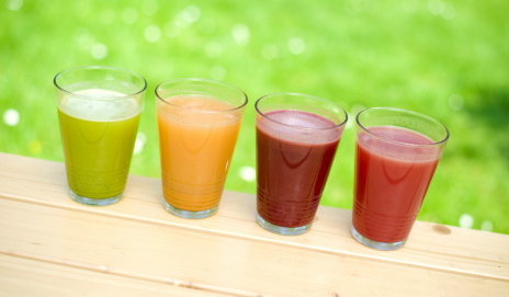 Four glasses of different fruit smoothies