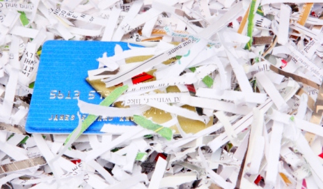 Credit card poking out from shredded paper