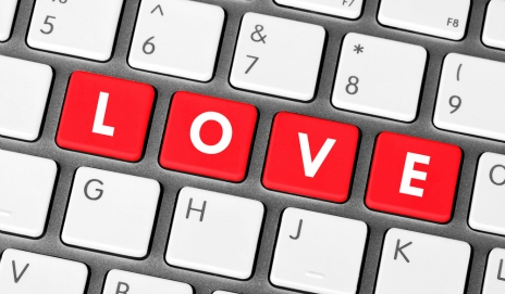 The word 'love' spelled out in red on a computer keyboard