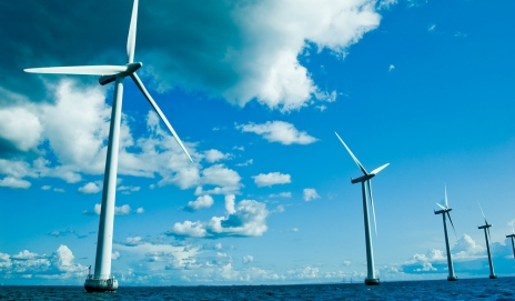 Offshore wind turbines against a blue sky